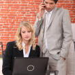 Stock Photo: Businessmand assistant watching laptop