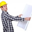 Builder going over construction plans — Stock Photo