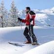 Man skiing on a sunny day - Stock Photo