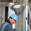 Tradesmen installing drywall — Stock Photo
