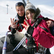 Young couple riding a ski lift - Stock Photo