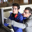 Young apprentice in industry sector with tutor — Stock Photo