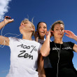 Teen girls walking outdoors and listening music — Stock Photo
