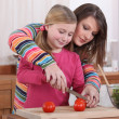 Mother and daughter cooking together — Stock Photo #9205357