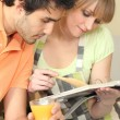 Couple with cook book — Stock Photo