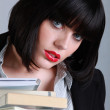 Brunette woman with stack of books - Stock Photo