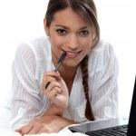 Woman using a laptop computer — Stock Photo