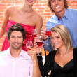 Two young couples drinking wine in restaurant — Stock Photo #9207508