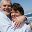 Stock Photo: Mature couple on the beach