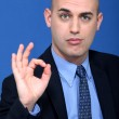 Bald businessman making ok gesture — Stock Photo #9208169