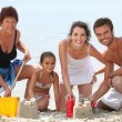 Family having fun at beach — Stock Photo #9208250