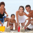 Family having fun at the beach — Stock Photo