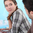 Two students flirting in class — Stockfoto