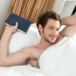 Man relaxing in his bed — Stock Photo #9208717