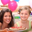 Cheerful woman and little girl celebrating birthday — Stock Photo