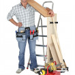 Craftsman holding a wooden floor board — Stock Photo