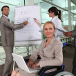 Female executive in wheelchair — Stock Photo