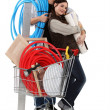 Couple with trolley full of supplies — Foto de stock #9209299