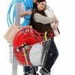 Stock Photo: Couple with trolley full of supplies