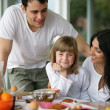 Family having breakfast together — Stock Photo #9209627
