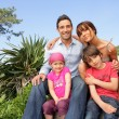 Young family in the garden — Stock Photo #9209757