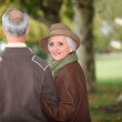 Senior couple walking in the park — Stock Photo