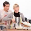 Couple baking together — Stock Photo
