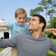 Father and son playing in the garden — Stock Photo #9209890