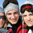 Stock Photo: Three teenagers on a ski vacation