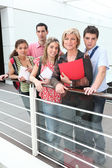 Teacher standing with students — Stock Photo