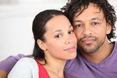 Portrait of young coloured couple — Stock Photo