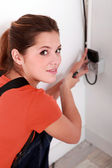 Woman repairing an electrical outlet — Foto Stock