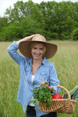 Woman with vegetables basket — Stock Photo