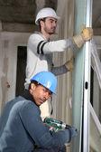 Tradesmen installing drywall — Stock Photo