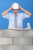 Stressed architect reviewing plans — Stock Photo