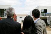 Estate agent showing a couple a housing development — Stock Photo