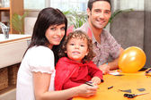 A family making Halloween preparations. — Stock Photo