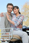 Couple on a walk with a motorcycle — Stock Photo