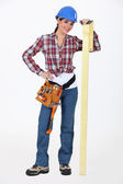 Female carpenter with set-square — Stock Photo