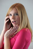 Blonde on the phone gossiping with friend — Foto Stock