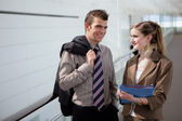 Two colleagues flirting in the corridor — Stock Photo