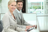 Smiling receptionists — Stock Photo