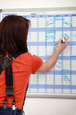 Female apprentice noting down appointments — Stock Photo