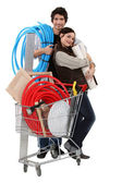 Couple with trolley full of supplies — Stock Photo