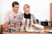 Couple baking together — Stock Photo