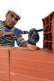 Mason carving bricks — Stock Photo