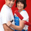 A couple painting their wall in red. — Stock Photo #9210151