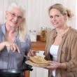 Women making crepes — Stock Photo