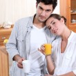 A nice couple having morning drinks. — Stock Photo #9210454