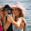 Women posing for picture on beach — Stock Photo #9210532